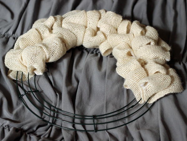 wreath halfway completed with burlap ribbon