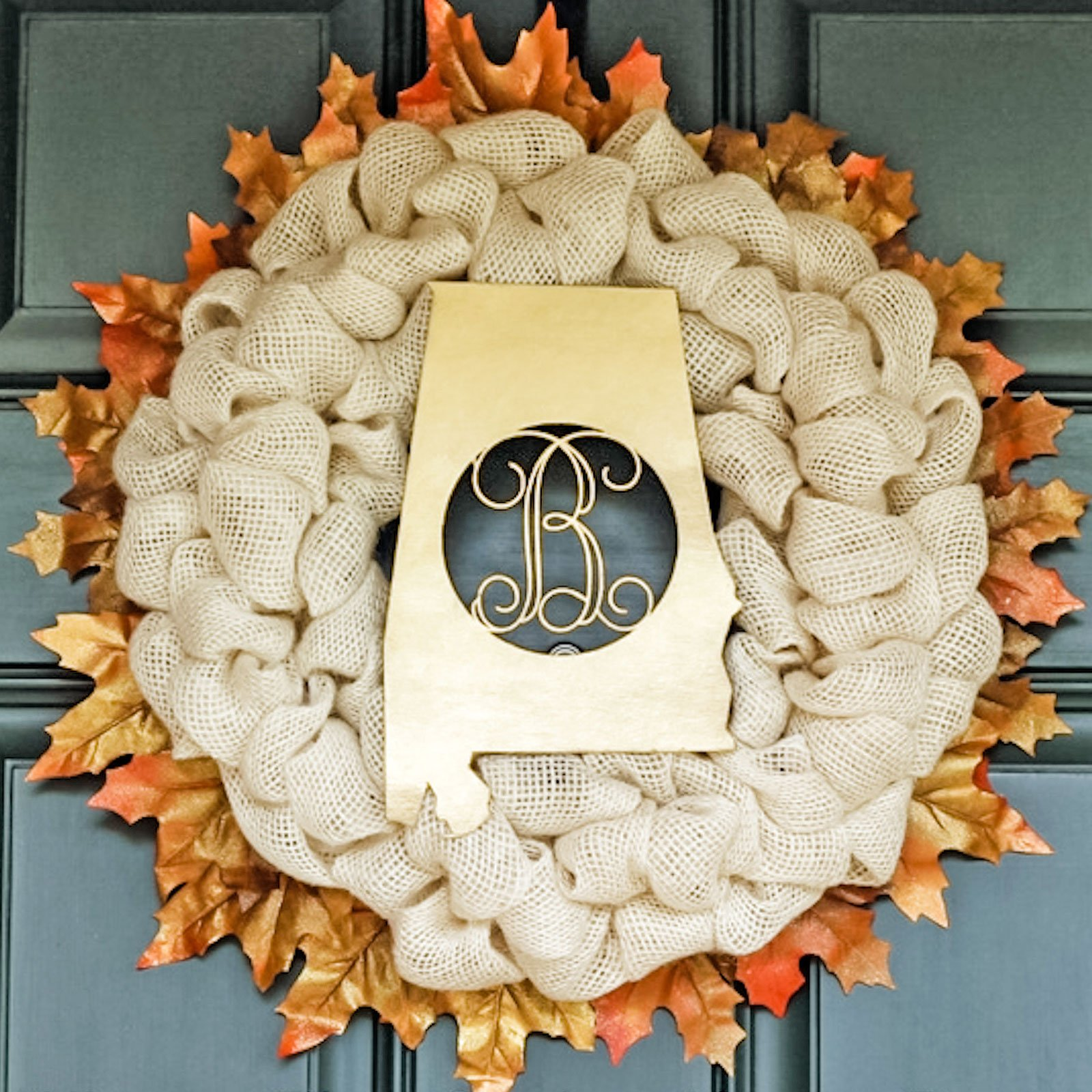 Fall burlap wreath with golden leaves around the edge and a gold monogram