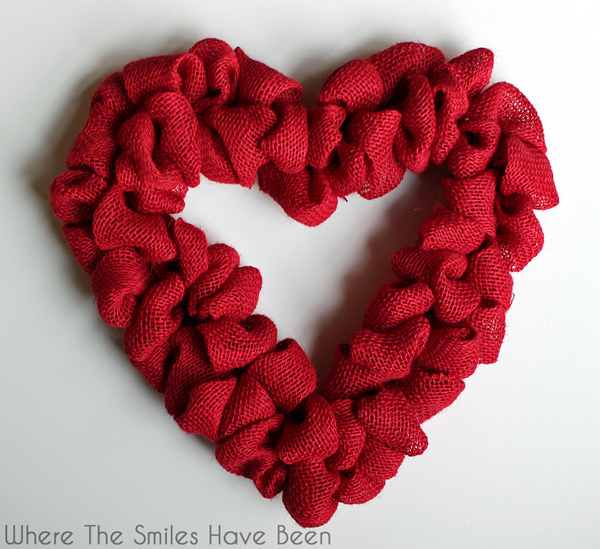 Heart wreath form with red burlap poufs