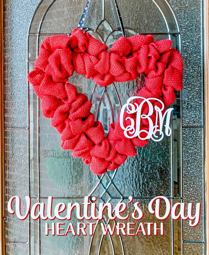 Red burlap Valentine's Day heart wreath hanging on a glass door