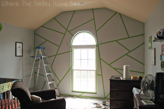 Accent wall with painter's tape lines applied.