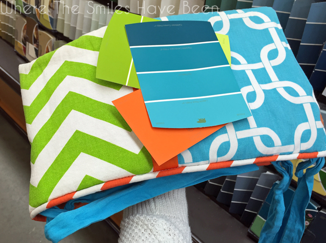 Blue, green, and orange paint chips matching a crib rail guard.