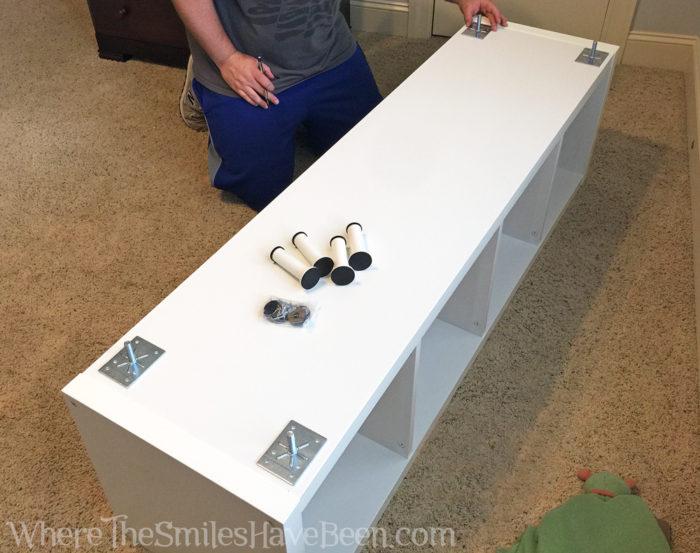 Adding legs to an IKEA Kallax shelf.