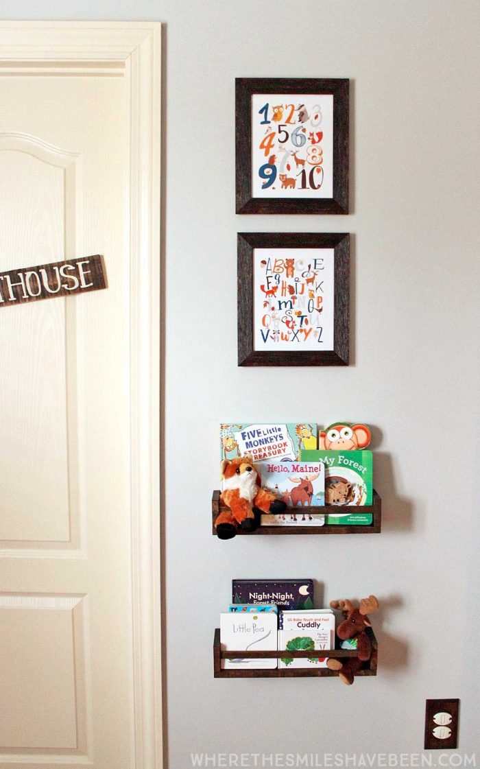 This is the cutest little display in a baby's room! Take a tour of this navy & orange modern woodland nursery!   Where The Smiles Have Been