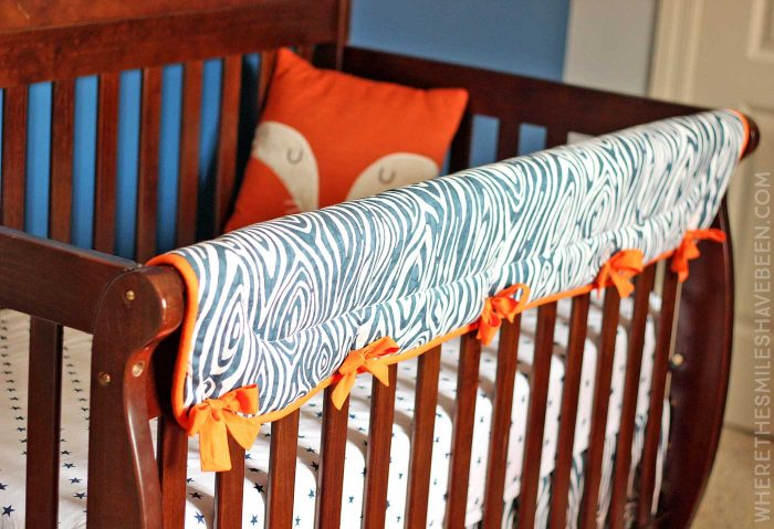 LOVE this woodgrain crib rail guard! It's perfect for a rustic or woodland nursery! Take a tour of this Navy & Orange Modern Woodland Nursery!   Where The Smiles Have Been