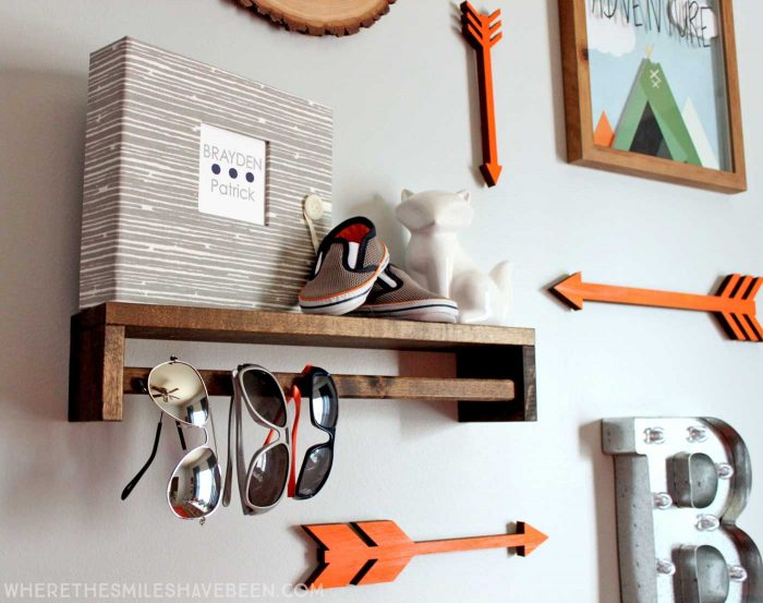 LOVE this mini gallery wall in a baby's room! That shelf is great! Take a tour of this navy & orange modern woodland nursery!   Where The Smiles Have Been