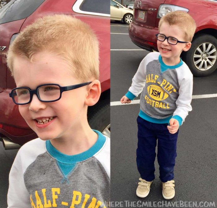 Boy wearing glasses and smiling
