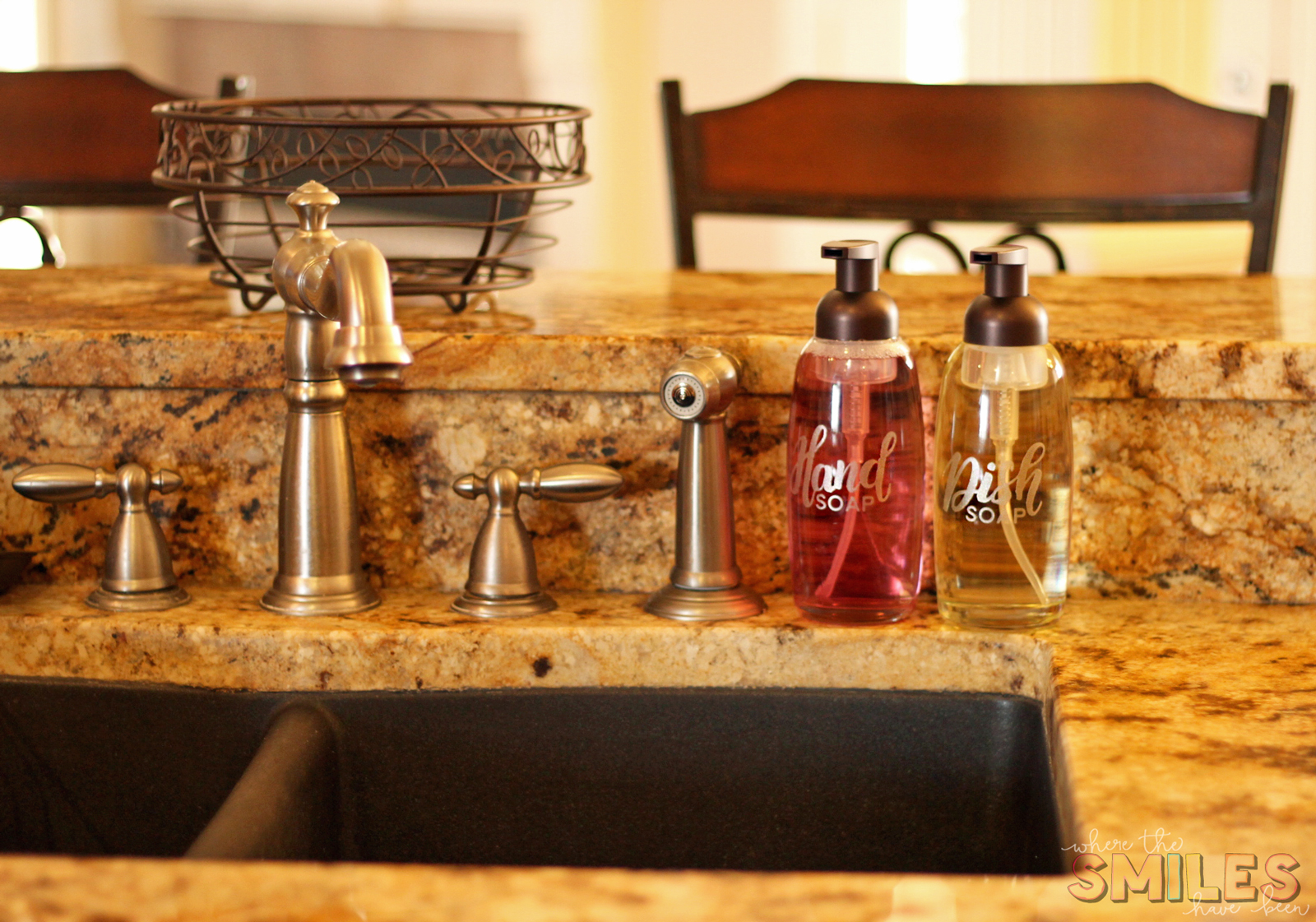 Pretty Foaming Soap Dispensers with Etched Glass Vinyl decals sitting near kitchen sink