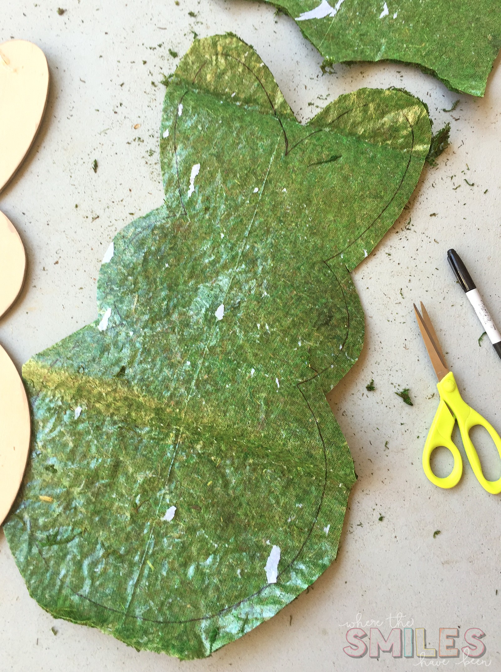 Cutting out the moss for the bunny door hanger