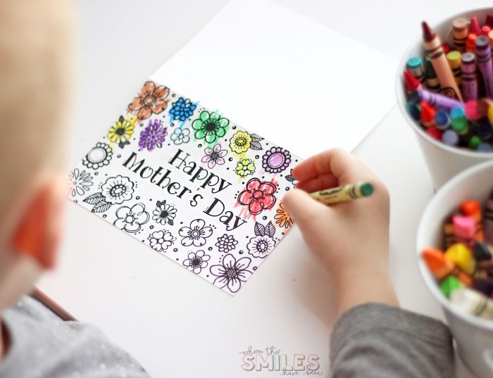 Child coloring a Free Printable Mother's Day Card & Coloring Page.