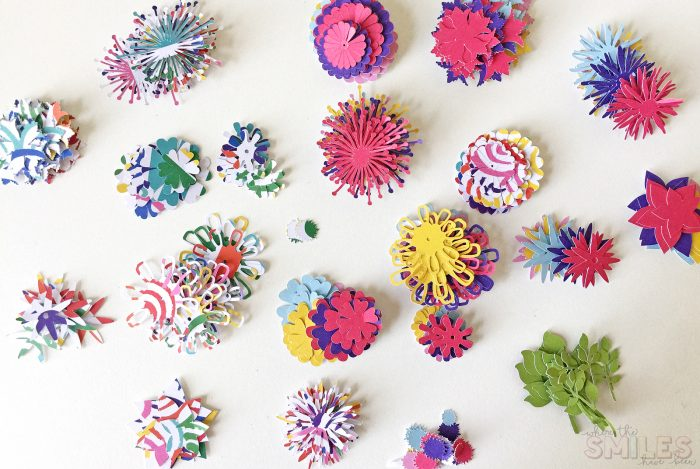 A collection of colorful paper flowers awaiting assembly.