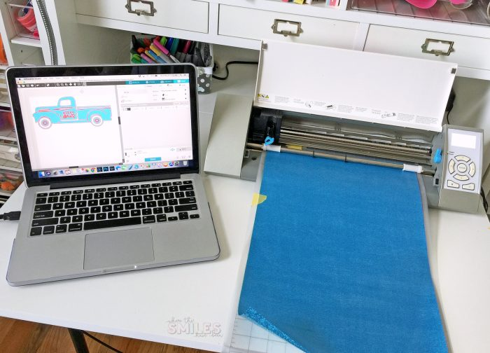 Cutting a glitter heat transfer vinyl decal out with a Silhouette Cameo.