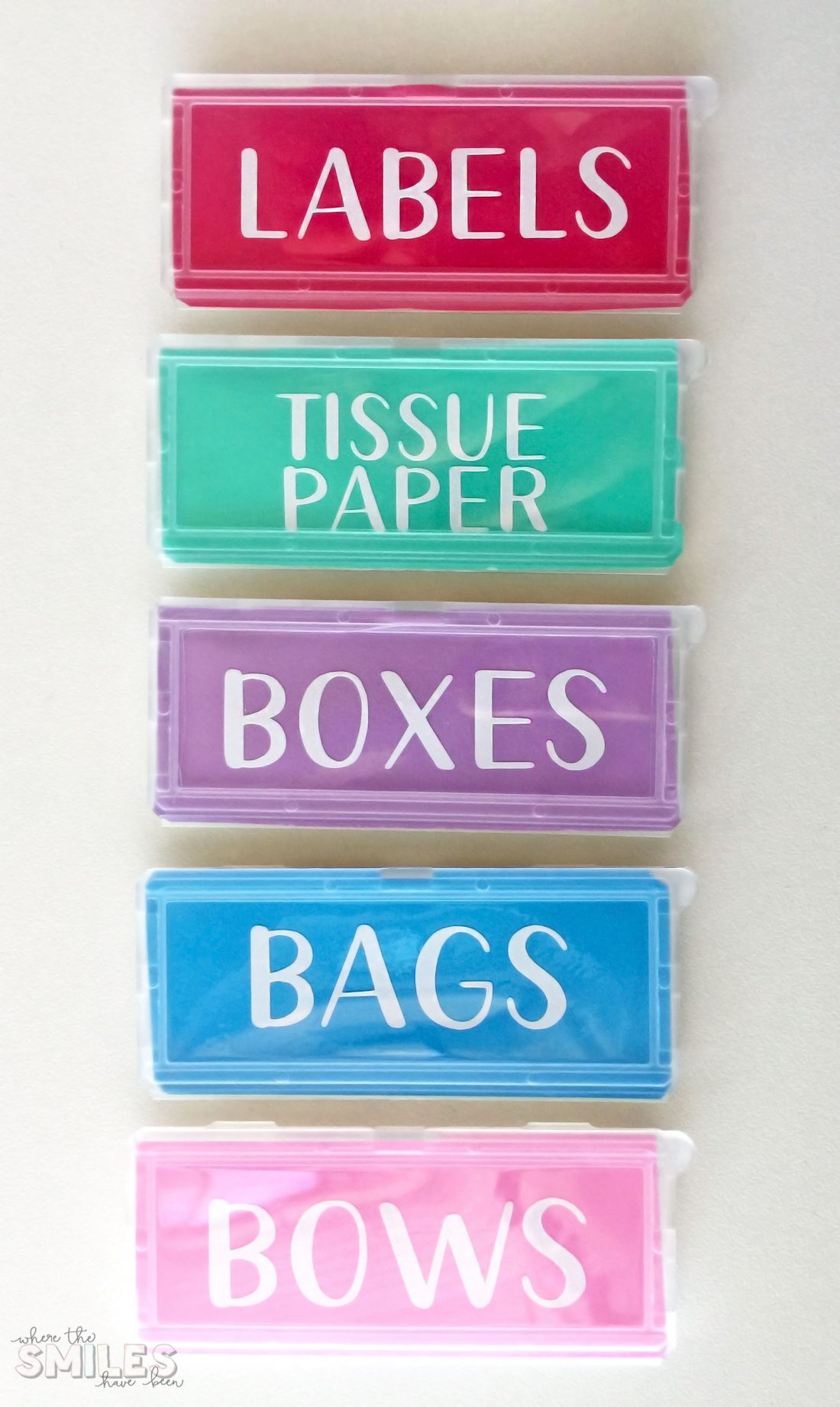 Gift Wrap Organizer Cart for wrapping paper supplies with DIY vinyl labels created with a Silhouette Cameo.