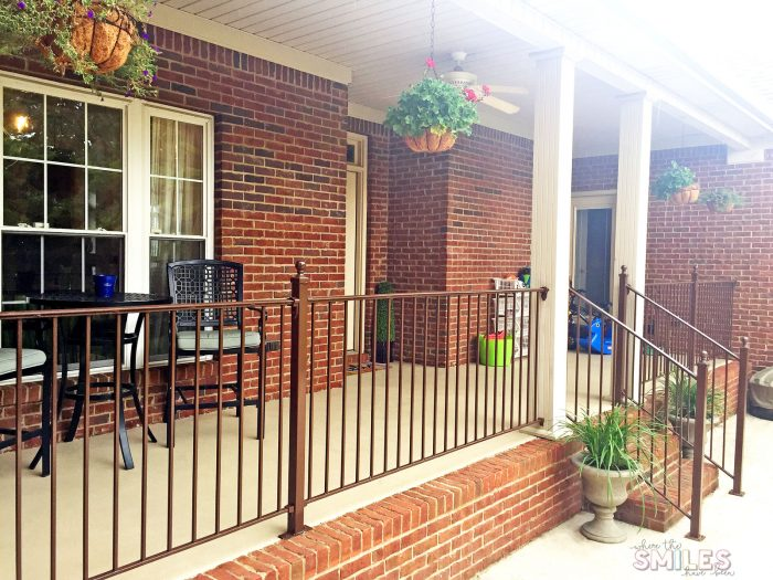 Pretty repainted back porch with hanging baskets.