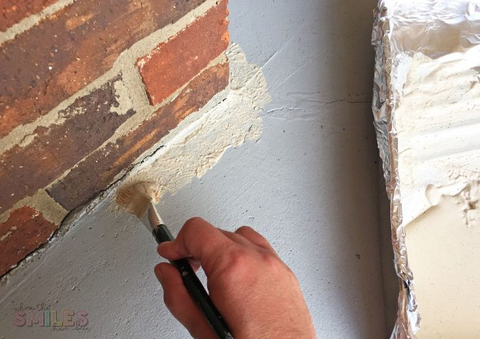 Repainting a Porch by painting the edges by hand.