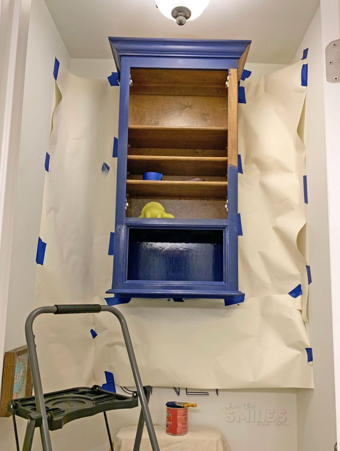 Painting bathroom cabinets blue.