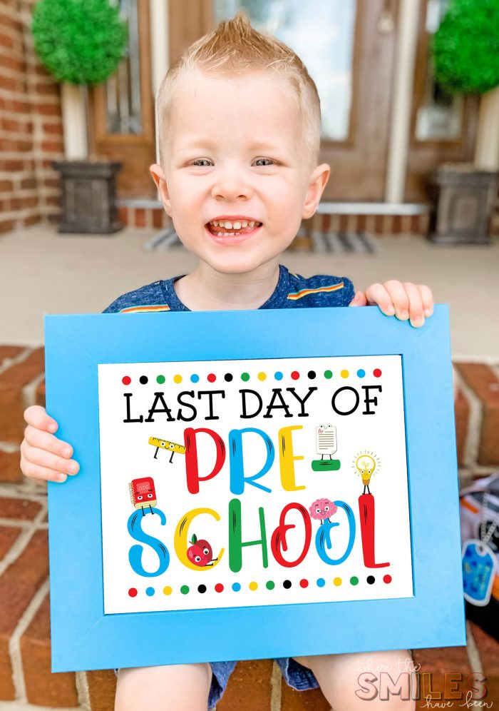Young boy smiling with a FREE Last Day of School Sign Printable